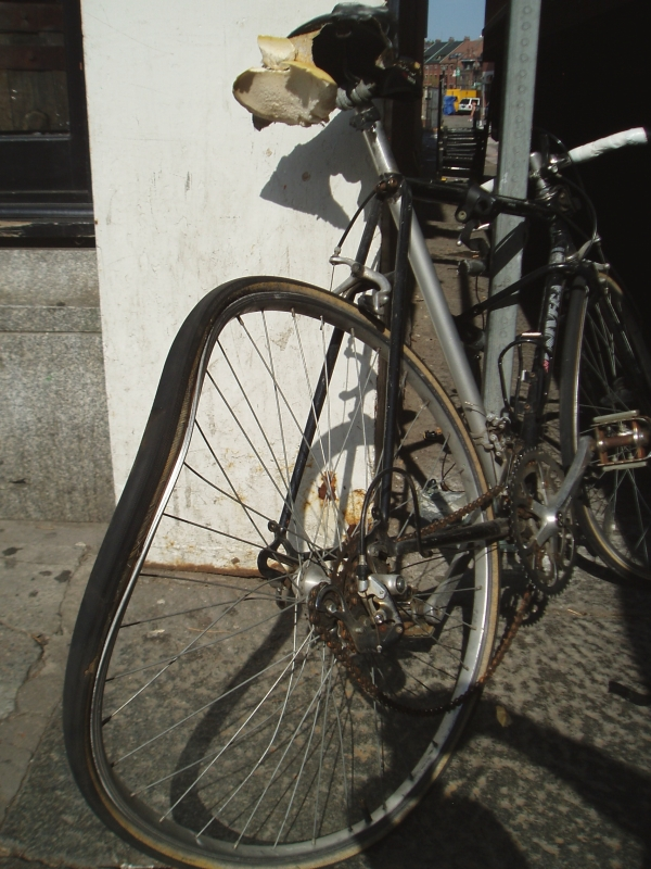 Smashed urban commuter bike in downtown Boston